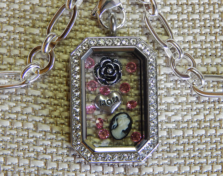 Heritage locket with Deco chain & charms